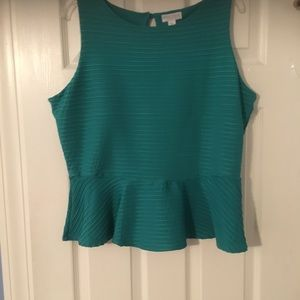 A pretty green top with a skirted waist.